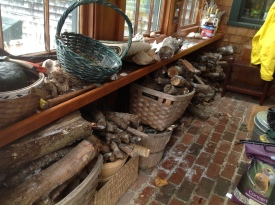 The entry filled with firewood and birdseed